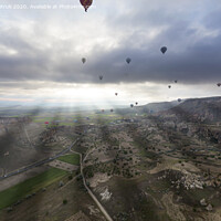 Buy canvas prints of Balloons fly over the valleys in Cappadocia by Sergii Petruk