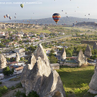 Buy canvas prints of Dozens of balloons fly over the valleys in Cappadocia by Sergii Petruk