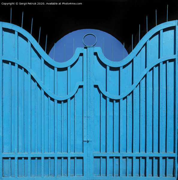 Exemplary metal gate-fence with outdated bright blue paint. Abstract texture background. Print by Sergii Petruk