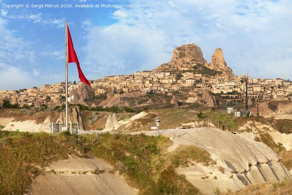 Great national flag of Turkey. Cave Uchhisar. Cappadocia, Turkey. Print by Sergii Petruk