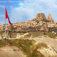 Buy canvas prints of Great national flag of Turkey. Cave Uchhisar. Cappadocia, Turkey. by Sergii Petruk