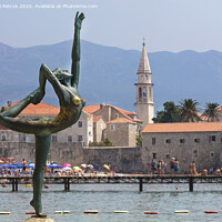 Buy canvas prints of The statue of Ballerina Dancer, standing on the rock. Budva, August 2018. by Sergii Petruk