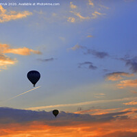Buy canvas prints of Silhouettes of balloons on the background of the morning sky with fiery red clouds. by Sergii Petruk