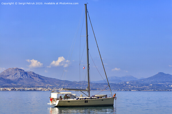 Sailing sea yacht anchored in the morning haze in the Corinthian bay. Framed Print by Sergii Petruk