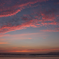 Buy canvas prints of Fluffy pink clouds during sunset at Pismo Beach, C by Carmen Green