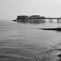 Buy canvas prints of Cromer pier in grayscale by PAUL OLBISON