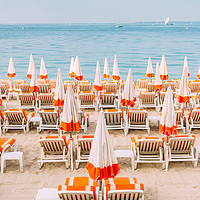 Buy canvas prints of Rows of empty beach lounges in Juan les Pins, Fran by Alexandre Rotenberg
