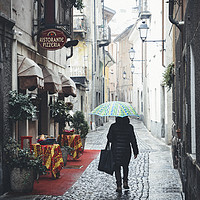 Buy canvas prints of Quaint Italian damp street by Alexandre Rotenberg