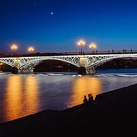 Buy canvas prints of Puente de Triana or Triana Bridge, Seville, Spain by Alexandre Rotenberg