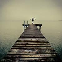Buy canvas prints of Ballerina pose at idyllic lake at winter by Alexandre Rotenberg