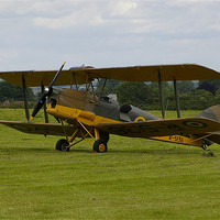 Buy canvas prints of An old Tiger moth aeroplane by Randal Cheney