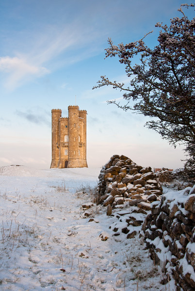 Broadway tower in winter snow.  Canvas print by Andrew Michael
