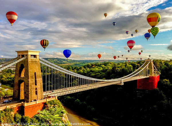 Hot air balloons over Clifton suspension bridge Canvas Print by Claire Turner