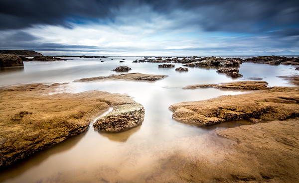 Incoming Tide at North Beach, Scarborough, England Canvas Print by Tim Hill