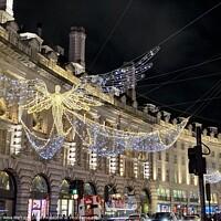 Buy canvas prints of Christmas lights on Regent Street, London by Ailsa Darragh