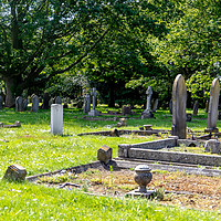 Buy canvas prints of Gaywood Church graveyard by Clive Wells