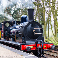Buy canvas prints of Steam train at Holt Station in North Norfolk by Clive Wells