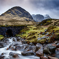 Buy canvas prints of Mountain stream by the The Three Sisters of Glenco by Phill Thornton