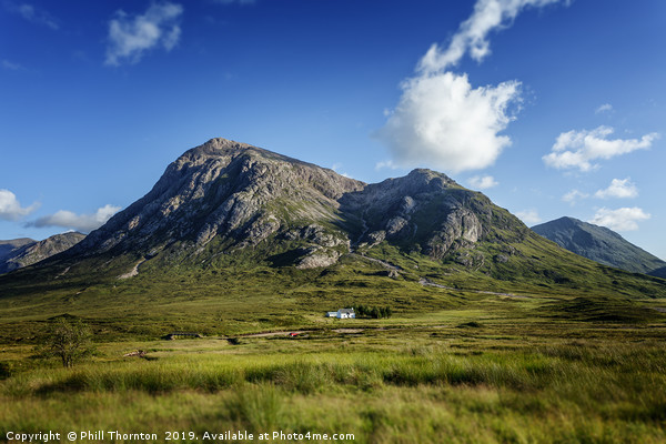 Blue skies over over Stob Dearg Canvas print by Phill Thornton