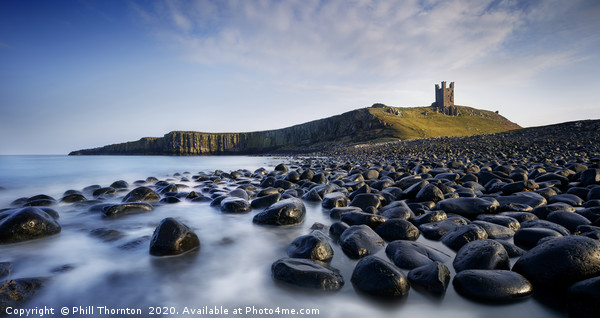 Dunsanburgh Castle and the North Sea. Canvas print by Phill Thornton