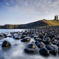 Buy canvas prints of Dunsanburgh Castle and the North Sea. by Phill Thornton