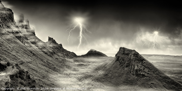 Lightning strikes over the Quiraing, Skye. Canvas Print by Phill Thornton