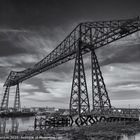 Buy canvas prints of Blue skies above the Tees Transporter bridge. B&W. by Phill Thornton