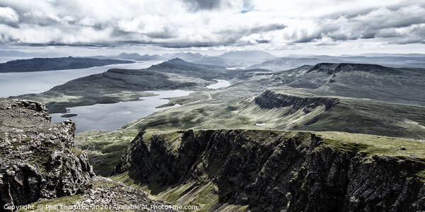 Dramatic skies from the top of the Storr, Isle of Skye. Framed Print by Phill Thornton