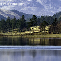 Buy canvas prints of Distant Scottish Shore, Loch Tulla with the Black Mount in the background. by David Thurlow