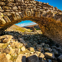 Buy canvas prints of An Old Stone Archway at Old Gang Mill by David Brookens