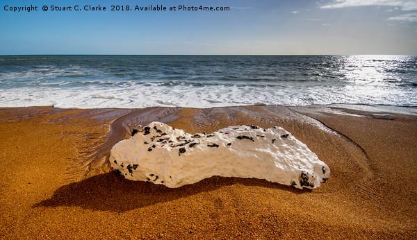 Rocky beach Canvas print by Stuart C. Clarke