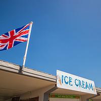 Buy canvas prints of Union Jack at the seaside by Stuart C Clarke