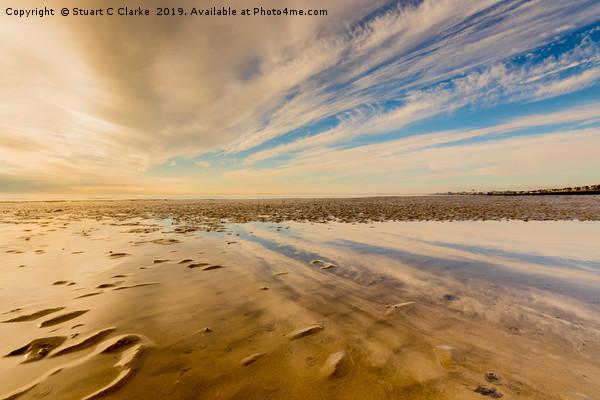 Low tide beach reflections Canvas print by Stuart C Clarke