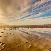 Buy canvas prints of Low tide beach reflections by Stuart C Clarke