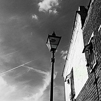 Buy canvas prints of Black and white street light framed photo print by Cherise Man