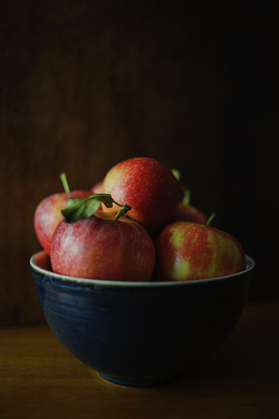 Red Apples in Blue Bowl Canvas print by Cassi Moghan