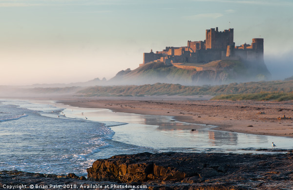 Dawn reflections of Bamburgh Canvas print by Brian Pain