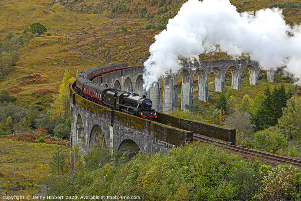 Steam train crossing Glenfinnan Viaduct Framed Print by Jenny Hibbert