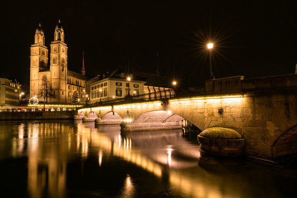 Grossmuenster Cathedral in Zurich at night Canvas Print by Nando Lardi
