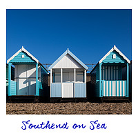 Buy canvas prints of Southend Beach Hut Trio in Blue by Dave Denby