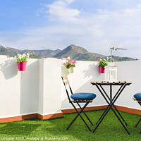 Buy canvas prints of Beautiful white terrace with chairs and coffee table overlooking the Mediterranean mountain, blue sky. by Joaquin Corbalan