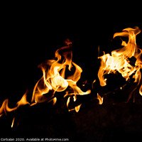 Buy canvas prints of Flames in the fire of a red and yellow barbecue. by Joaquin Corbalan