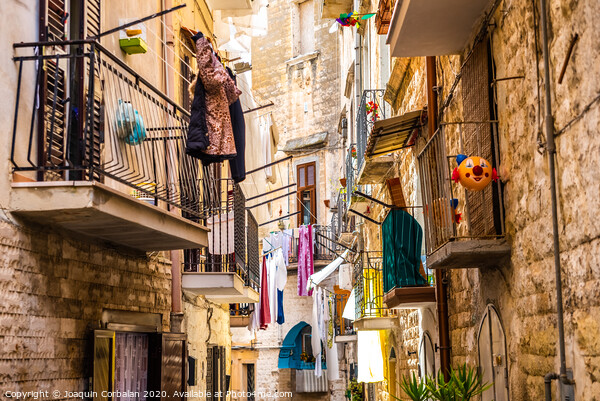 Colorful and old alleys of the touristic Italian city of Bari. Acrylic by Joaquin Corbalan