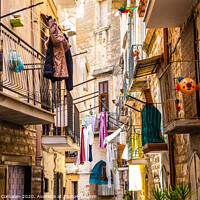 Buy canvas prints of Colorful and old alleys of the touristic Italian city of Bari. by Joaquin Corbalan