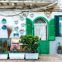 Buy canvas prints of Facades of old Italian Mediterranean houses in Bari painted in colors. by Joaquin Corbalan