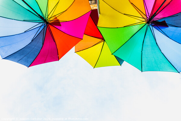 Colorful umbrellas to use as a background in bright and cheerful ideas. Framed Print by Joaquin Corbalan