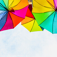 Buy canvas prints of Colorful umbrellas to use as a background in bright and cheerful ideas. by Joaquin Corbalan