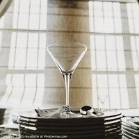 Buy canvas prints of Empty glass cup with sun flares background in a restaurant. by Joaquin Corbalan