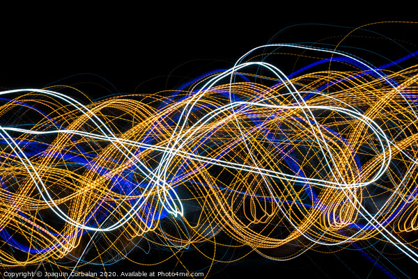 Colorful light painting with circular shapes and abstract black background. Canvas Print by Joaquin Corbalan