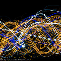 Buy canvas prints of Colorful light painting with circular shapes and abstract black background. by Joaquin Corbalan
